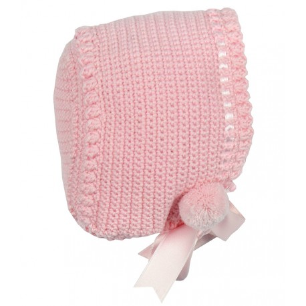 Capota de lana rosa hecha a mano con cinta y pompón