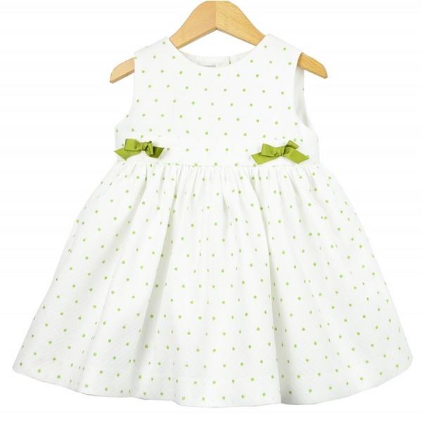 Vestido blanco de piqué con bodoques verdes para niña